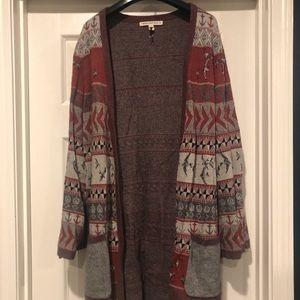 Beautiful long patterned sweater.